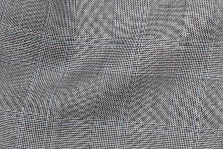 Close up view of Light Grey Prince of Wales Fabric in Super 120s