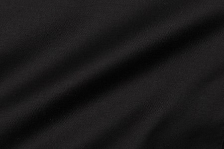 Close up view of Timeless Black Plain Fabric in Super 130s