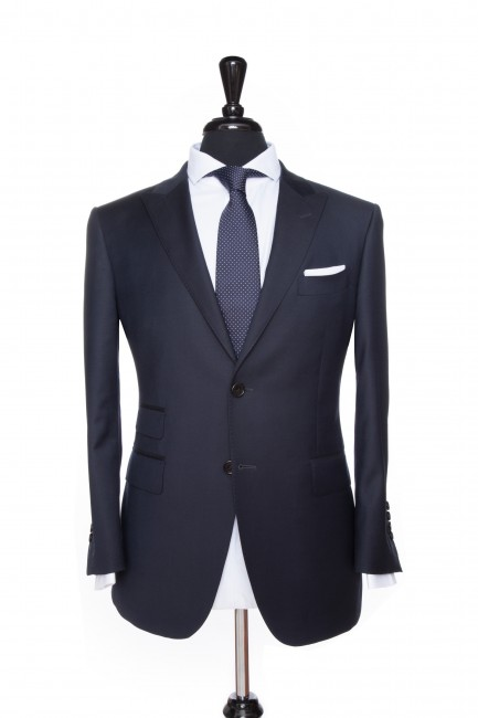Front Mannequin View of Pocket Square's Manhattan Midnight Navy Suit with peak lapels and black buttons