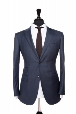 Front Mannequin View of Pocket Square's Navy Plain Suit with peak lapels and black buttons