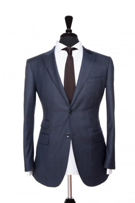 Front Mannequin View of Pocket Square's Navy Plain Suit with peak lapels and black buttons