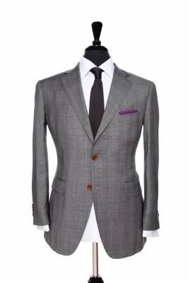 Front Mannequin view of Pocket Square's Grey Prince of Wales suit with brown button customisation